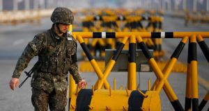 A South Korean soldier sets up a barricade at a checkpoint on the Grand Unification Bridge, which leads to the demilitarized zone separating North Korea from South Korea, in Paju, north of Seoul today. Photograph: Reuters