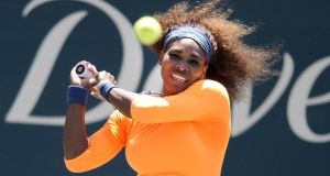 Serena Williams hits a backhand shot during a semifinal match against her sister Venus Williams at the Family Circle Cup tennis tournament in Charleston, S.C., Saturday, April 6, 2013. Serena won 6-1, 6-2. (AP Photo/Stephen Morton)