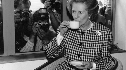 Thatcher enjoys a cup of tea at the opening of a motorway service area in 1987. Photograph: Keystone/Getty Images