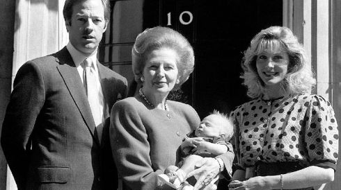 Thatcher with her son Mark, daughter-in-law Diane, and two-month-old grandson Michael. Photograph: PA Wire
