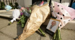 Flowers laid outside the home of Margaret Thatcher in Belgravia, London following her death this morning after a stroke. Photograph: Yui Mok/PA Wire