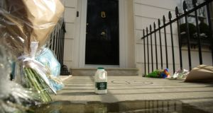 A pint of milk is laid next to flowers outside the home of  Margaret Thatcher in Belgravia, London following her death. Photograph: Yui Mok/PA Wire