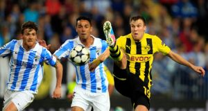 Dortmund (yellow and black) played out a stalemate with Malaga in the first leg of the Champions League quarter-final in Spain. Photograph: Reuters