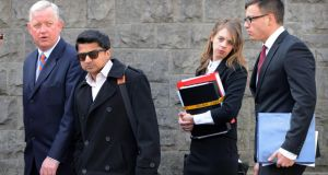 Praveen Halappanavar, the husband of the late Savita Halappanavar, with members of his legal team, arriving at her inquest in Galway. Photograph: Eric Luke/The Irish Times