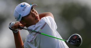 Asia-Pacific Amateur Championship winner, 14-year-old Guan Tianlang of China, hits his tee shot on the 10th hole during a practice round. Photograph: Brian Snyder/Reuters