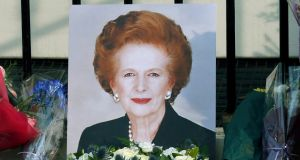 A portrait left by mourners is seen outside the home of former British prime minister Margaret Thatcher after her death was announced in London. Photograph: REUTERS/Suzanne Plunkett