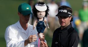 Defending champion Bubba Watson with his caddie Ted Scott during a practice round for this weekend's Masters.