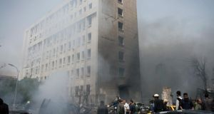 The damage left by a car bomb near the Syrian Central Bank in Damascus yesterday. Photograph:  New York Times