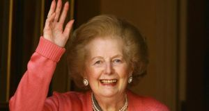 Margaret Thatcher waves from the front door of her home after returning from the Chelsea and Westminster Hospital following an operation on her broken arm on June 29, 2009 in London, England. Photograph: Oli Scarff/Getty Images