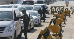 A South Korean soldier checks media vehicles  before they go to South's CIQ (Customs, Immigration and Quarantine), just south of the demilitarised zone separating the two Koreas. Photograph: Lim Byong-sik/Yonhap/Reuters
