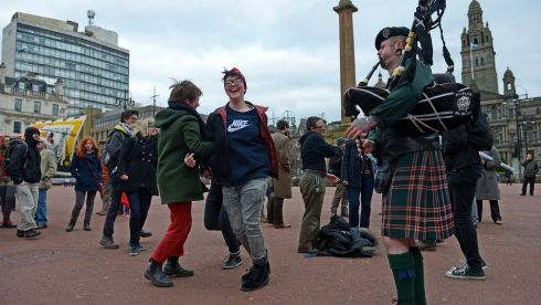 Members of the public dance in George Square to mark the death of Baroness Margaret Thatcher in Glasgow. Photograph: Jeff J Mitchell/Getty Images
