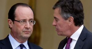 French president Francois Hollande  speaks to junior minister for budget Jerome Cahuzac at the end of a government meeting about employment and the economic situation in France at the Elysee Palace in Paris in January. Photograp: Philippe Wojazer/Reuters