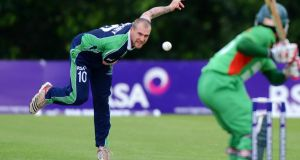 Ireland international cricketer John Mooney in action against Bangladesh at Stormont last summer. Photograph:  Rowland White/Inpho/Presseye