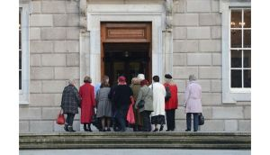 Magdalene women on their way into the Dail  to sit in the public gallery for the debate on the McAleese Magdalene report and an apology from Enda Kenny on behalf of the State. Photograph: Alan Betson/The Irish Times