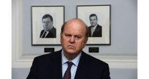 Taoiseach Enda Kenny has defended the timing of the legislation and said Minister for Finance Michael Noonan had to be in London today.