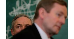 Minister for Jobs, Enterprise and Employment Richard Bruton and Taoiseach Enda Kenny at a jobs announcement in Dublin last week. Photograph: Julien Behal/PA Wires
