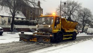 A snow plough clears the roads in Earsdon near Whitley Bay as snow and sleet will hit parts of north England today as freezing winds sweep across Britain. Photograph: PA
