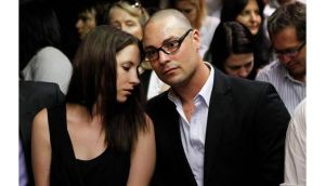 Carl Pistorius  and his sister Aimee are seen during court proceedings in the Pretoria Magistrates court for his brother Oscar. Photograph: Reuters