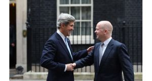 Foreign secretary William Hague (R)  and US Secretary of State John Kerry shake hands as they leave 10 Downing Street today. Photograph: Dan Kitwood/Getty Images