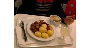 A woman sits down to a lunch of Swedish meatballs at an Ikea store in Prague. Photograph: Petr Josek/Reuters
