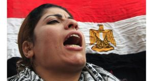 A protester shouts in front of a national flag during during an anti-government protest in Cairo last week. Photograph: Mohamed Abd El Ghany/Reuters