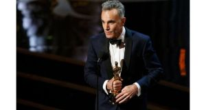 Daniel Day-Lewis accepts the Oscar for best actor for his role in Lincoln  at the 85th Academy Awards in Hollywood, California, last night. Day Lewis is the first actor to win three best actor Oscars. Photograph: Mario Anzuoni/Reuters