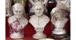 Souvenir statues of Pope John Paul II,,Pope Benedict XVI  and Jesus for sale in Rome. Photograph: Peter Macdiarmid/Getty Images