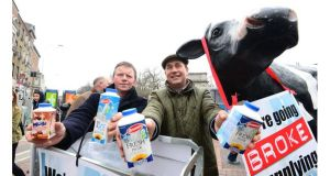 Farmers Larry Hannon (left) from Kildare and Donal Murphy from Wexford hand out milk at a protest by the Irish Farmer?s Association  in Dublin's Grafton Street today. Photograph: Bryan O'Brien/The Irish Times