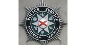 A rocket launcher and warhead were discovered by police in west Belfast last night.