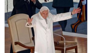 Pope Benedict XVI waves to the faithful in St Peter's Square at the Vatican during his last general audience this morning. Photograph:  Tony Gentile/Reuters