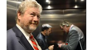 Minister for Health James Reilly smiles as two Department of Health officials attempt to open the door of a lift in which they became stuck at a mental health facility on the old Grangegorman site in Dublin. Photograph: Brenda Fitzsimons/Irish Times