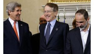 US secretary of state John Kerry (left) smiles next to Italian foreign minister Giulio Terzi, and Syrian National Coalition president Mouaz al-Khatib during a group photocall during meetings at Villa Madama in Rome. Photograph: Jacquelyn Martin/Pool