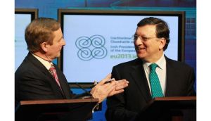 Taoiseach Enda Kenny applauds European Commission president Jose Manuel Barroso after he spoke a few words of Irish at the Government Press Centre in Dublin this afternoon. Photograph: Julien Behal/PA Wire