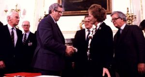 Then taoiseach Garret FitzGerald shakes hands with Margaret Thatcher after signing the Anglo Irish Agreement.