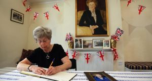 Tessa Phillips, who worked at the Finchley Conservative office between 1977 and 2009, signs a book of condolence at the party headquarters in Finchley yesterday. Photograph: Dan Kitwood/Getty Images