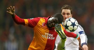 Galatasaray's Emmanuel Eboue is challenged by Real Madrid's Raphael Varane in Istanbul. Photograph: Murad Sezer/Reuters
