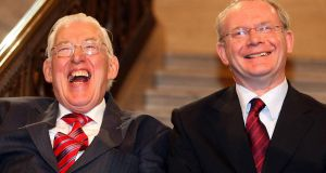 First Minister Ian Paisley and Deputy First Minister Martin McGuinness smiling after being sworn in as Ministers of the Northern Ireland Assembly, Stormont, in May  2007.  Photograph:  Paul Faith