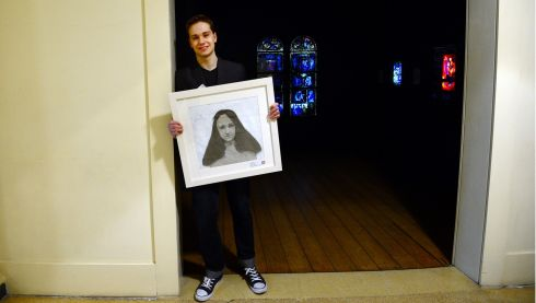 First prize winner Simon Minias (16) a fifth year student of Gorey Community School with his portrait study 'My Sister Sophie' at the Hugh lane Gallery Dublin yesterday. Photograph: Bryan O'Brien/The Irish Times