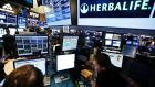 Traders work at the post that trades Herbalife stock on the floor of the New York Stock Exchange. KPMG resigned as the auditor of Herbalife Ltd after one of its senior partners engaged in insider trading in Herbalife stock. Photograph: Brendan McDermid/Reuters