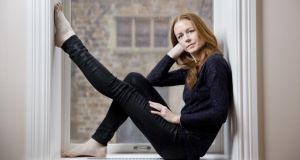 Closer to the ground: Jean Butler at home in New York; with Michael Flatley in Riverdance; and in her contemporary dance, Hurry. Photographs: Marcus Yam/The New York Times; Ian Douglas