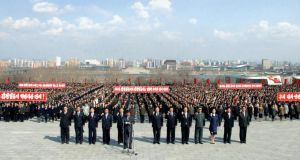 People take part in an oath-taking meeting before the statues of late North Korean leaders Kim Il-sung and Kim Jong-il on Mansudae Hill in Pyongyang yesterday. Photograph: Reuters
