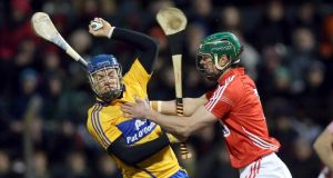 Shane O'Donnell of Clare battles for possession with Cork's Brian Murphy when the two sides met in Division One  A last month. Photograph: Donall Farmer/Inpho
