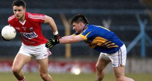 Cork's Jamie Wall evades the challenge of Donagh Leahy of Tipperary in the under-21 Munster final.
