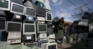 Old computer monitors being recycled in Beijing, China, this week. First-quarter shipments of PCs fell 14 per cent worldwide from the same time last year, according to International Data Corporation - the deepest quarterly drop since the firm started tracking the industry in 1994. Photograph: China Daily/Reuters