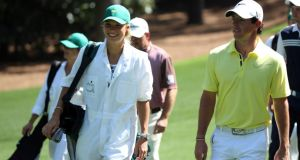 Rory McIlroy  walks with his caddie Caroline Wozniacki during the Par 3 Contest prior to the start of the Masters. Photograph: Andrew Redington/Getty Images
