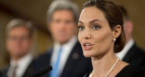 Actress and humanitarian campaigner Angelina Jolie speaks at a news conference on sexual violence against women during the G8 meeting in central London today. Photograph: Alastair Grant/Pool/Reuters