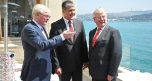 John McSweeney, head of Innovation at ESB; Serdar Bilgiç, head of energy generation at Unit; and Minister for Foreign Affairs and Trade Eamon Gilmore at the announcement in Istanbul that ESB International has won its first contract in Turkey valued at €30 million