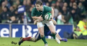 Eoin Reddan in action against France in the match in which he broke his leg.