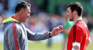 Rob Penney speaks to Peter O'Mahony prior to kickoff against Harlequins. The Munster coach got so much right on the day.  Photograph: Warren Little/Getty Images