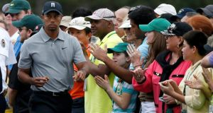 Tiger Woods is applauded as he walks to the first tee during the first round of the  Masters  at the Augusta National Golf Club. Photograph: Mike Segar/Reuters
